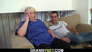Blonde granny with big tits pleases young stranger
